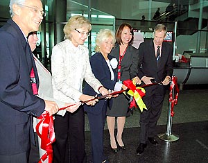Cutting the ribbon for the first flight are: Marcello Korner, Air Berlin Deputy Station Manager, Miami; Maria Portuondo, Air Berlin Area Manager, North America; Consul General of the Federal Republic of Germany, Eva Alexandra Countess Kendeffy; Kristina M. Harmon, Air Berlin Sales Manager, Southeast USA; Nelly Castaneda, Air Berlin Regional Station Manager for Miami and Fort Myers; and Ken Pyatt, MDAD Deputy Director of Operations.